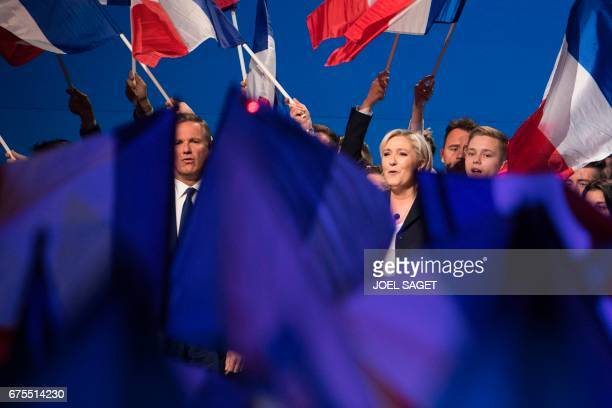 TOPSHOT French presidential election candidate for the farright Front National party Marine Le Pen and Former French presidential election candidate...