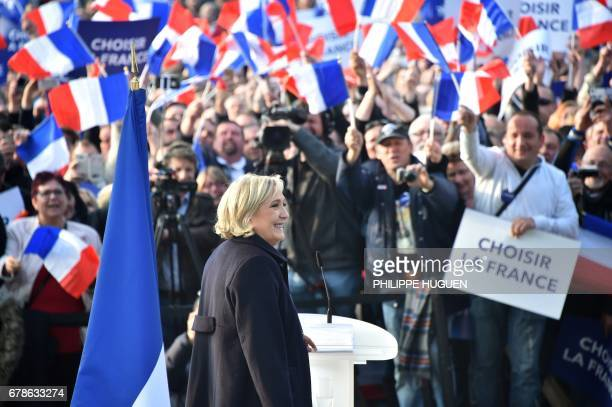 French presidential election candidate for the farright Front National party Marine Le Pen delivers a speech during a campaign meeting on May 4 2017...