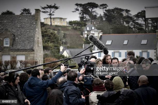 TOPSHOT French presidential election candidate for the leftwing French Socialist party Benoit Hamon speaks to journalists as he visits Trébeurden...