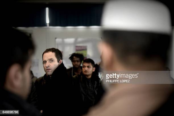 TOPSHOT French presidential election candidate for the leftwing French Socialist party Benoit Hamon meets migrants at the Maison de la Mer in...