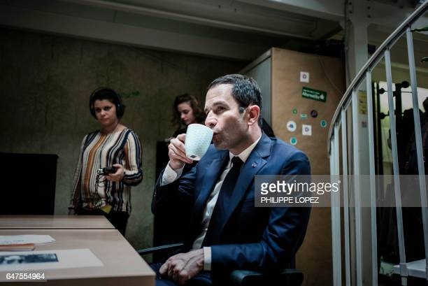 French presidential election candidate for the leftwing French Socialist party Benoit Hamon drinks a cup of tea during a visit at 'La Ruche' a...