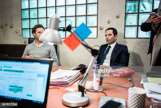 French presidential election candidate for the leftwing French Socialist party Benoit Hamon speaks during a visit at 'La Ruche' a coworking space for...