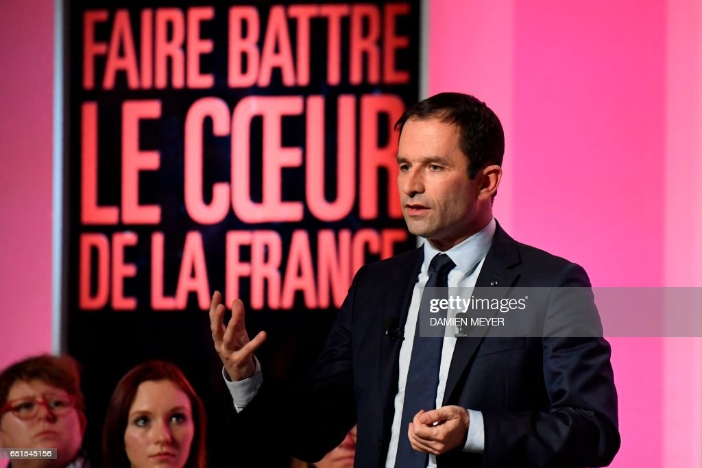 French presidential election candidate for the left-wing French Socialist (PS) party Benoit Hamon speaks on stage during a campaign rally in Le Havre on March 10, 2017. / AFP PHOTO / Damien MEYER