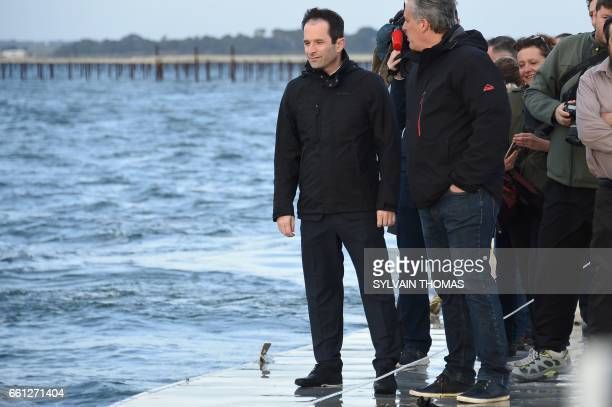 French presidential election candidate for the leftwing French Socialist party Benoit Hamon navigates on a barge during a visit to oysters farms on...