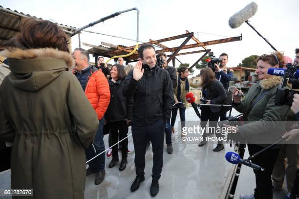 French presidential election candidate for the leftwing French Socialist party Benoit Hamon waves during a visit to oysters farms on the Etang de...