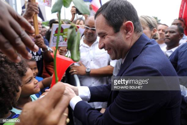 TOPSHOT French presidential election candidate for the leftwing French Socialist party Benoit Hamon greets his supporters upon his arrival at the...