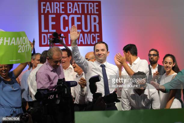French presidential election candidate for the leftwing French Socialist party Benoit Hamon waves after delivering a speech in SaintJoseph on April 1...