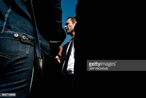 French presidential election candidate for the leftwing French Socialist party Benoit Hamon leaves a meeting with AREVA trade unions on April 7 2017...
