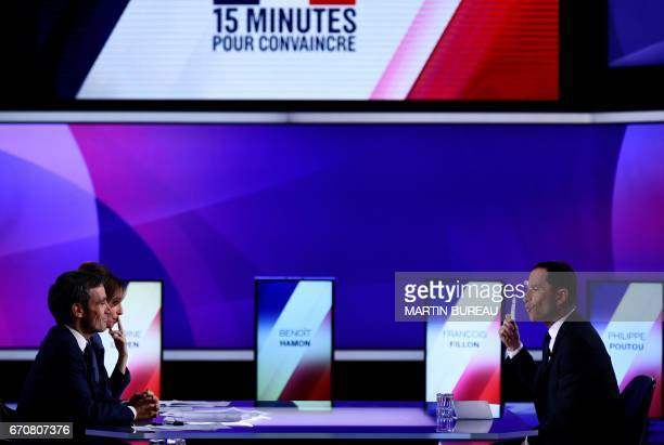 French presidential election candidate for the leftwing French Socialist party Benoit Hamon speaks with French journalists and television hosts David...