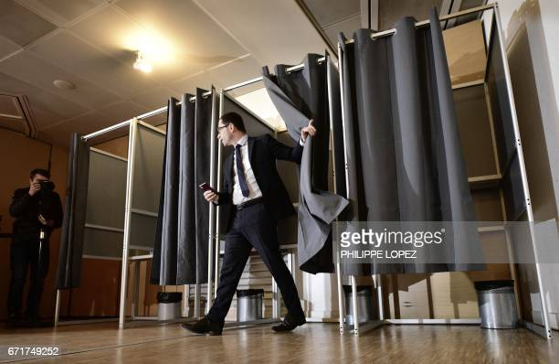 TOPSHOT French presidential election candidate for the leftwing French Socialist party Benoit Hamon leaves a polling booth as he votes at a polling...