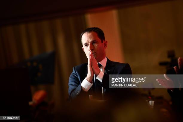 French presidential election candidate for the leftwing French Socialist party Benoit Hamon gestures as he delivers a speech at the Maison de la...