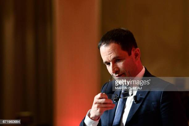 French presidential election candidate for the leftwing French Socialist party reacts as he Benoit Hamon reacts as he delivers a speech at the Maison...