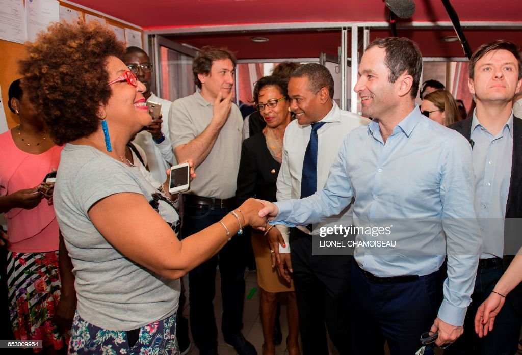 French presidential election candidate for the left-wing Socialist Party (PS) Benoit Hamon (2R) and French Socialist Party President of the General Council of Essonne Jerome Guedj (2L) meet with Mayor of Fort-France Didier Laguerre (3R) and other local politicians during a visit to the French overseas territory of Martinique on March 13, 2017. / AFP PHOTO / Lionel CHAMOISEAU