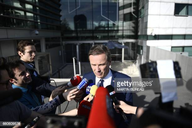 French presidential election candidate for the rightwing Debout la France party Nicolas DupontAignan talks to journalists on March 23 2017 outside...