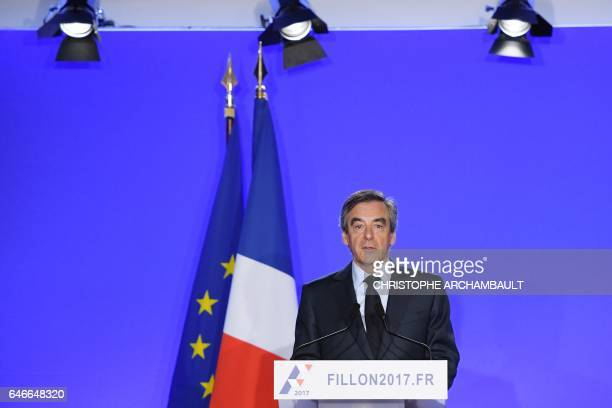 TOPSHOT French presidential election candidate for the rightwing Les Republicains party Francois Fillon delivers a speech during a press conference...