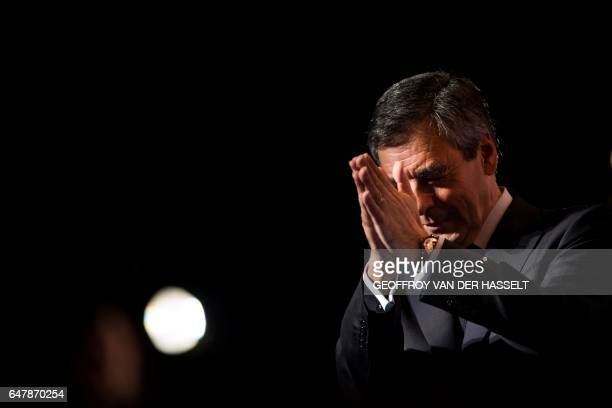 French presidential election candidate for the rightwing Les Republicains party Francois Fillon applauds the audience after delivering a speech to...