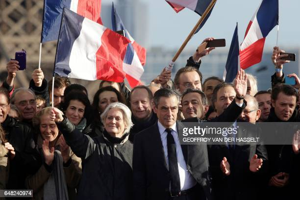 TOPSHOT French presidential election candidate for the rightwing Les Republicains party Francois Fillon gestures at his supporters as he stands by...