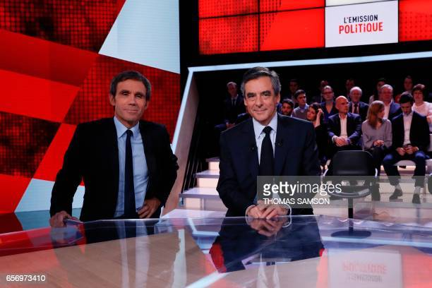 French presidential election candidate for the rightwing Les Republicains party Francois Fillon poses next to French journalist David Pujadas prior...