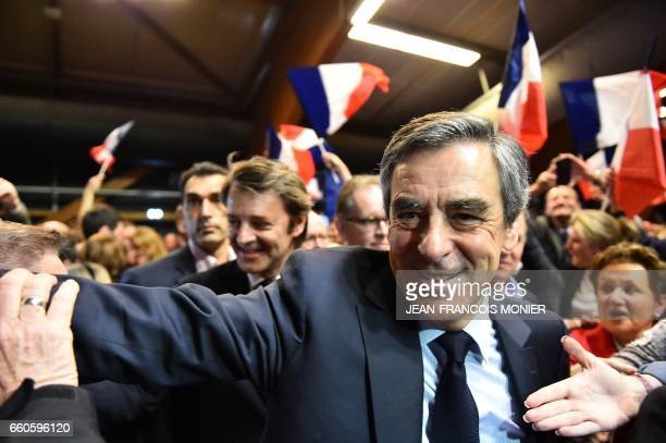 French presidential election candidate for the rightwing Les Republicains party Francois Fillon flanked by President of the Association of the Mayors...