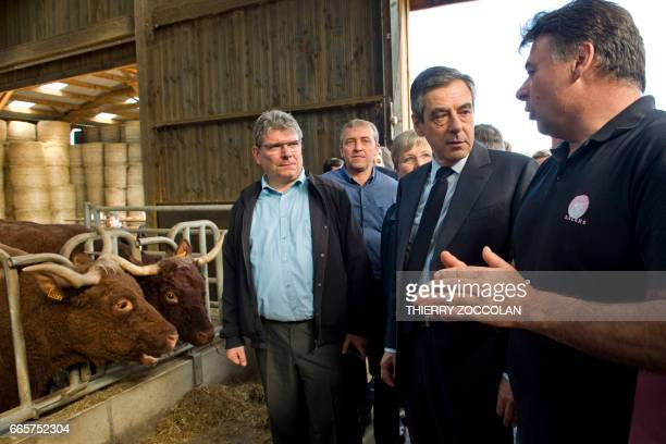 French presidential election candidate for the rightwing Les Republicains party Francois Fillon listens to a man on April 7 2017 during his visit in...