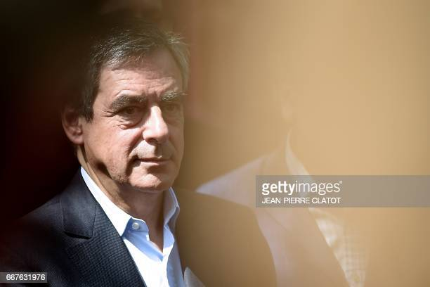 French presidential election candidate for the rightwing Les Republicains party Francois Fillon looks on as he arrives in AixlesBains for a meeting...