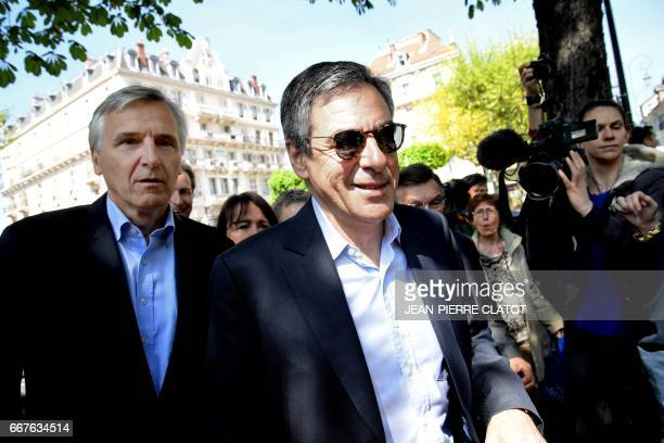 French presidential election candidate for the rightwing Les Republicains party Francois Fillon flanked by Mayor of AixlesBains Dominique Dord smiles...