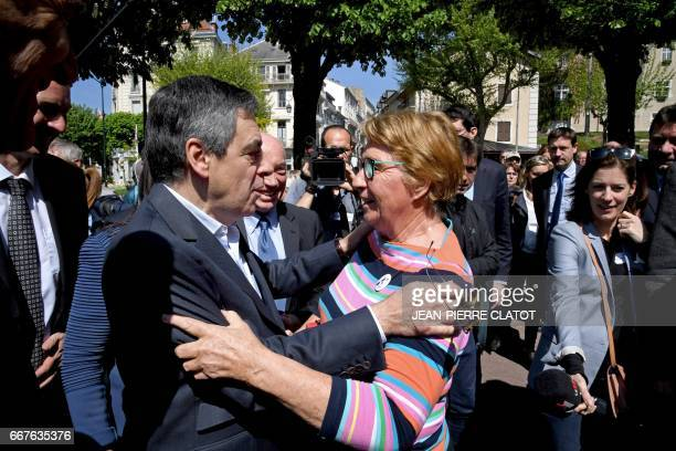 French presidential election candidate for the rightwing Les Republicains party Francois Fillon embrases French ski champion Marielle Goitschel upon...