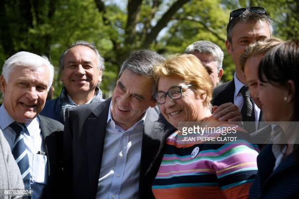 French presidential election candidate for the rightwing Les Republicains party Francois Fillon and French ski champion Marielle Goitschel pose...