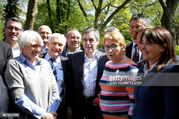 French presidential election candidate for the rightwing Les Republicains party Francois Fillon French ski champion Marielle Goitschel and Sophie...