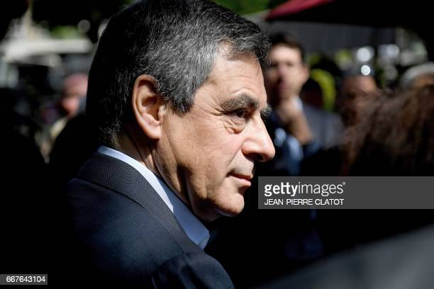 French presidential election candidate for the rightwing Les Republicains party Francois Fillon looks on upon his arrival in AixlesBains for a...