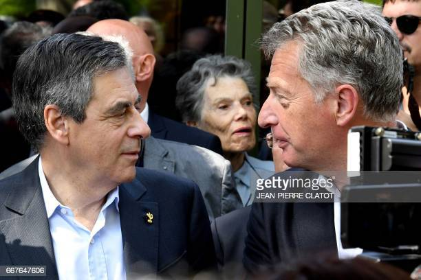 French presidential election candidate for the rightwing Les Republicains party Francois Fillon speaks with President of the regional council of...