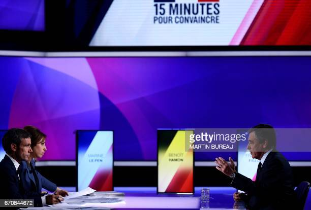 French presidential election candidate for the rightwing Les Republicains party Francois Fillon speaks with French journalists and television hosts...