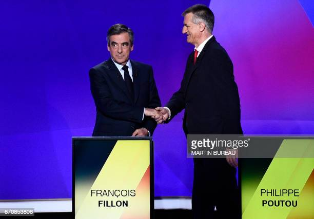 French presidential election candidate for the rightwing Les Republicains party Francois Fillon shakes hands with French presidential candidate Jean...