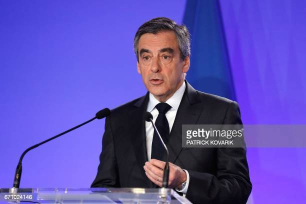 French presidential election candidate for the rightwing Les Republicains party Francois Fillon delivers a statement to the press at his campaign...