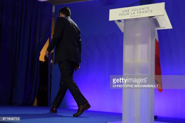 TOPSHOT French presidential election candidate for the rightwing Les Republicains party Francois Fillon leaves after delivering a speech at his...