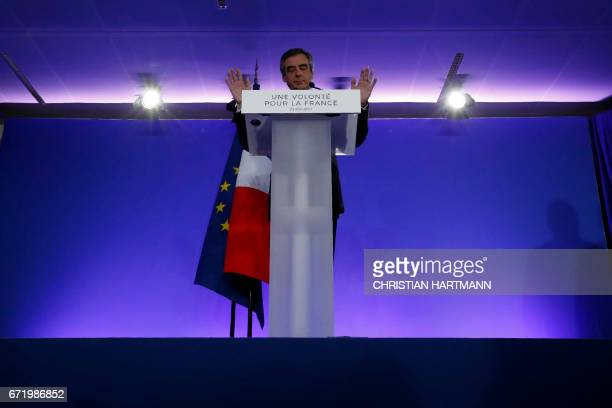 French presidential election candidate for the rightwing Les Republicains party Francois Fillon delivers a speech at his campaign headquarters in...