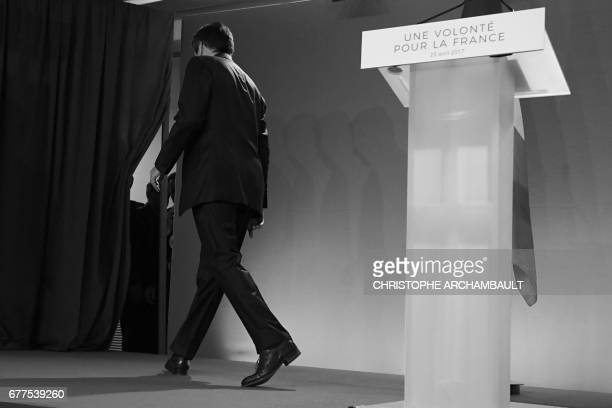 French presidential election candidate for the rightwing Les Republicains party Francois Fillon leaves after delivering a speech at his campaign...