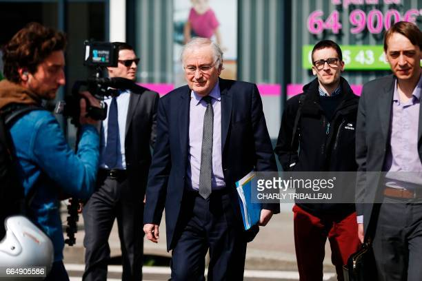 French presidential election candidate for the Solidarite et Progres party Jacques Cheminade walks at the harbour of Le Havre on April 5 2017 / AFP...