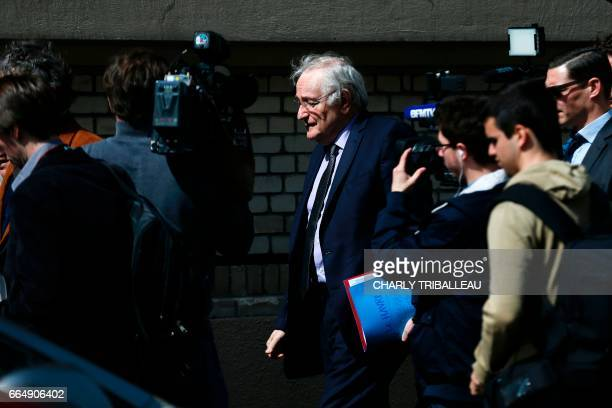 French presidential election candidate for the Solidarite et Progres party Jacques Cheminade walks surrounded by journalists at the harbour of Le...