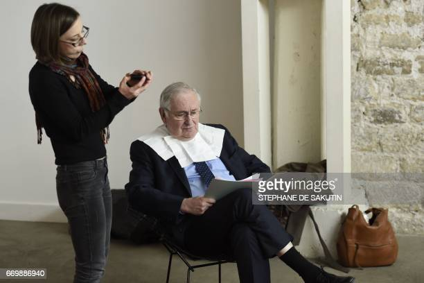 French presidential election candidate for the Solidarite et Progres party Jacques Cheminade prepares for a meeting in Paris on April 18 2017 / AFP...