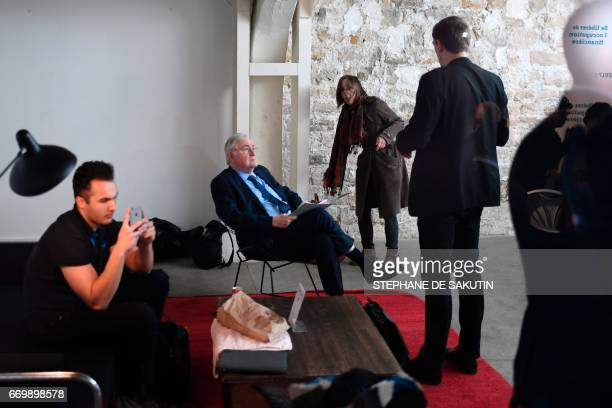 French presidential election candidate for the Solidarite et Progres party Jacques Cheminade prepares prior to a campaign meeting in Paris on April...
