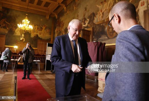 French presidential election candidate for the Solidarite et Progres party Jacques Cheminade prepares to cast his vote at a polling station in Paris...
