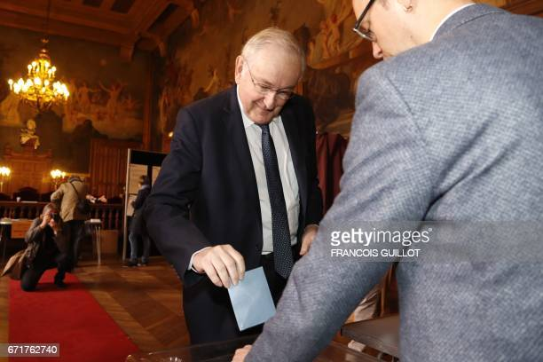 French presidential election candidate for the Solidarite et Progres party Jacques Cheminade casts his vote at a polling station in Paris on April 23...