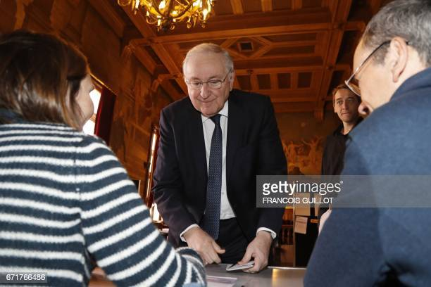 French presidential election candidate for the Solidarite et Progres party Jacques Cheminade prepares to vote at a polling station in Paris on April...