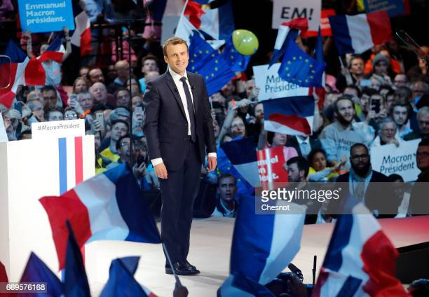 French presidential election candidate from the centrist 'En Marche' political party Emmanuel Macron waves to supporters during his political...