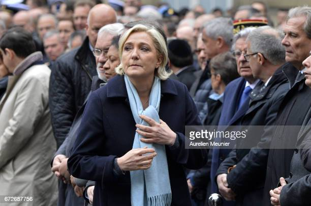 French Presidential Election candidate Marine Le Pen attends the National tribute to fallen French Policeman Xavier Jugele on April 25 2017 in Paris...