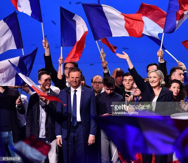 French Presidential Election candidate Marine Le Pen the leader of France's farright Front National political party greets next to Nicolas...