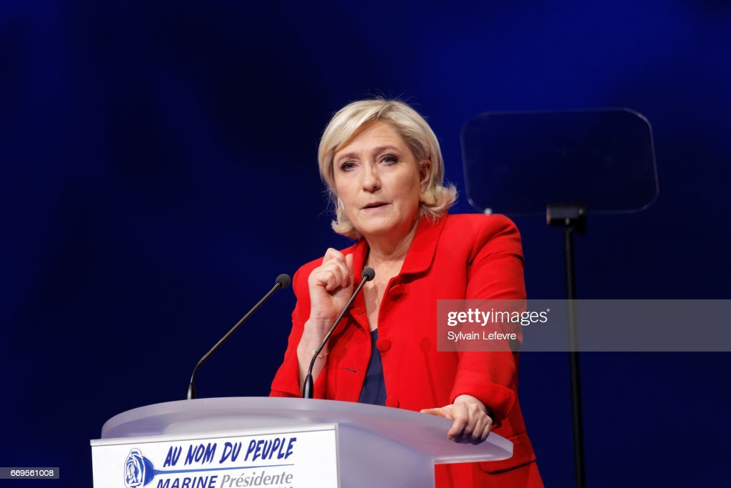 French presidential far-right candidate Marine Le Pen gestures as she delivers a speech during a campaign rally at Zenith on April 17, 2017 in Paris, France.