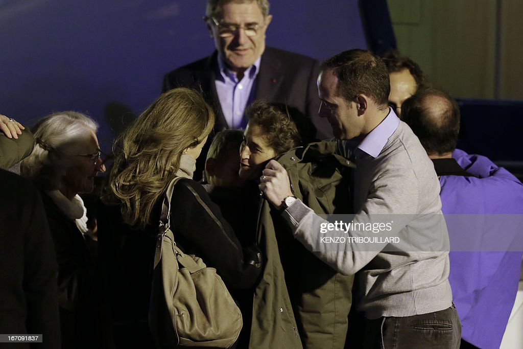 French President's companion Valerie Trierweiler (L) welcomes members of the Moulin-Fournier family arriving from Yaounde, at the Orly airport, near Paris, on April 20, 2013. A family of seven including four children who were held for two months by Islamists in Nigeria flew into Paris early Saturday days after having been released. French President Francois Hollande was waiting to welcome the Moulin-Fournier family at Orly airport just south of Paris, as they flew in from Cameroon, where they were freed late on April 18.