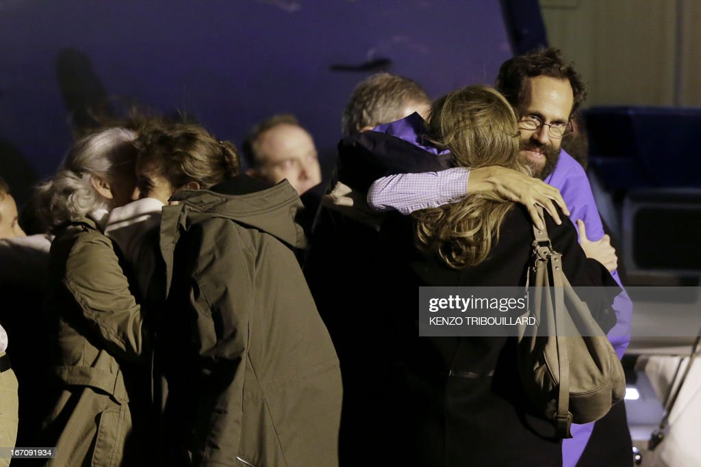 French President's companion Valerie Trierweiler (R) welcomes members of the Moulin-Fournier family arriving from Yaounde, at the Orly airport, near Paris, on April 20, 2013. A family of seven including four children who were held for two months by Islamists in Nigeria flew into Paris early Saturday days after having been released. French President Francois Hollande was waiting to welcome the Moulin-Fournier family at Orly airport just south of Paris, as they flew in from Cameroon, where they were freed late on April 18.